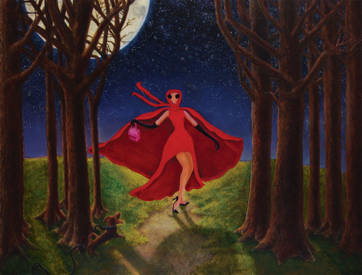 woman in red cloak in forest