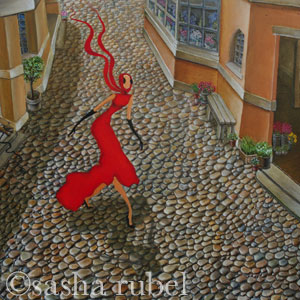 woman in red dress walking down cobblestone street